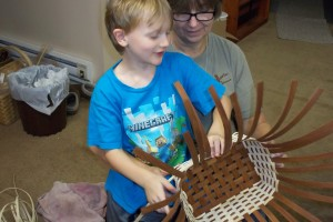 "Asher - ""Oma, you hold it while I weave."""