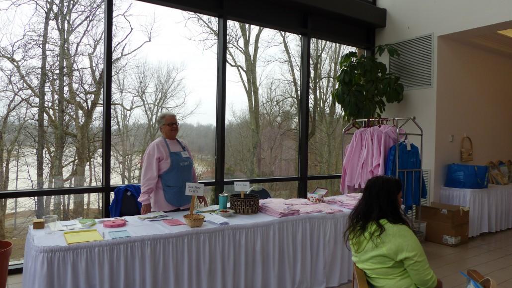 Carol tending the registration table